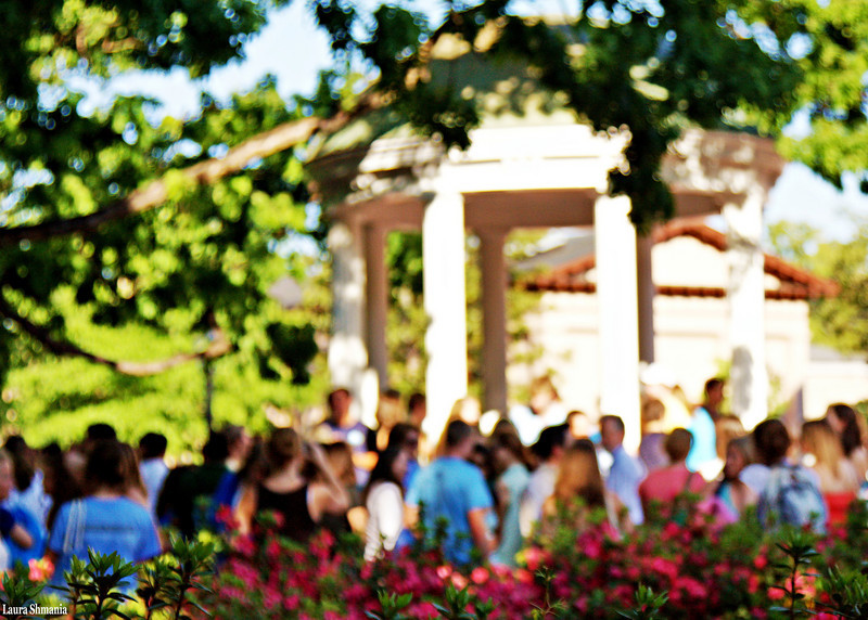 """4-29-09-- wednesday<br /> students gather by the old well on the last day of classes<br /> <br /> """"the future belongs to those who believe in the beauty of their dreams.""""<br /> <br /> --  eleanor roosevelt"""
