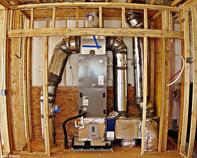 "4-26-09-- saturday<br /> went on the greenhomes tour.  this is a ""high efficiency, zoned-bypass air conditioning system""  the house also has radiant heat concrete floors with solar water heater, roof garden, high efficiency windows, and 12"" thick spray foam insulation... not looking to buy, just for some ideas...<br /> <br /> ""home wasn't built in a day.""<br /> <br /> -- jane ace"