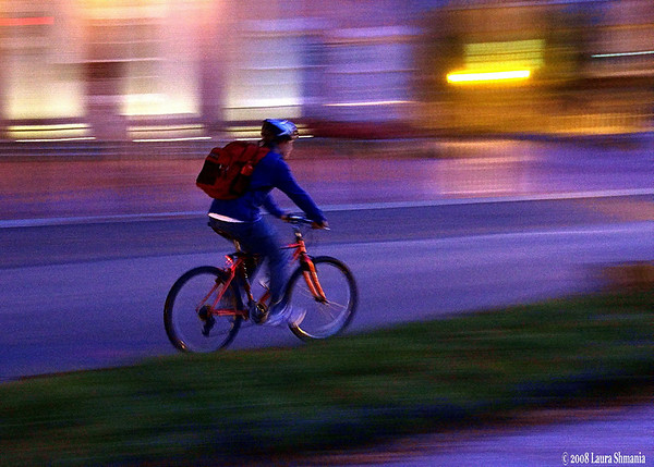 """10-27-08-- monday<br /> panning shot of a cyclist on campus<br /> <br /> <br /> """"cycle tracks will abound in utopia.""""<br /> <br /> -- h.g. wells"""