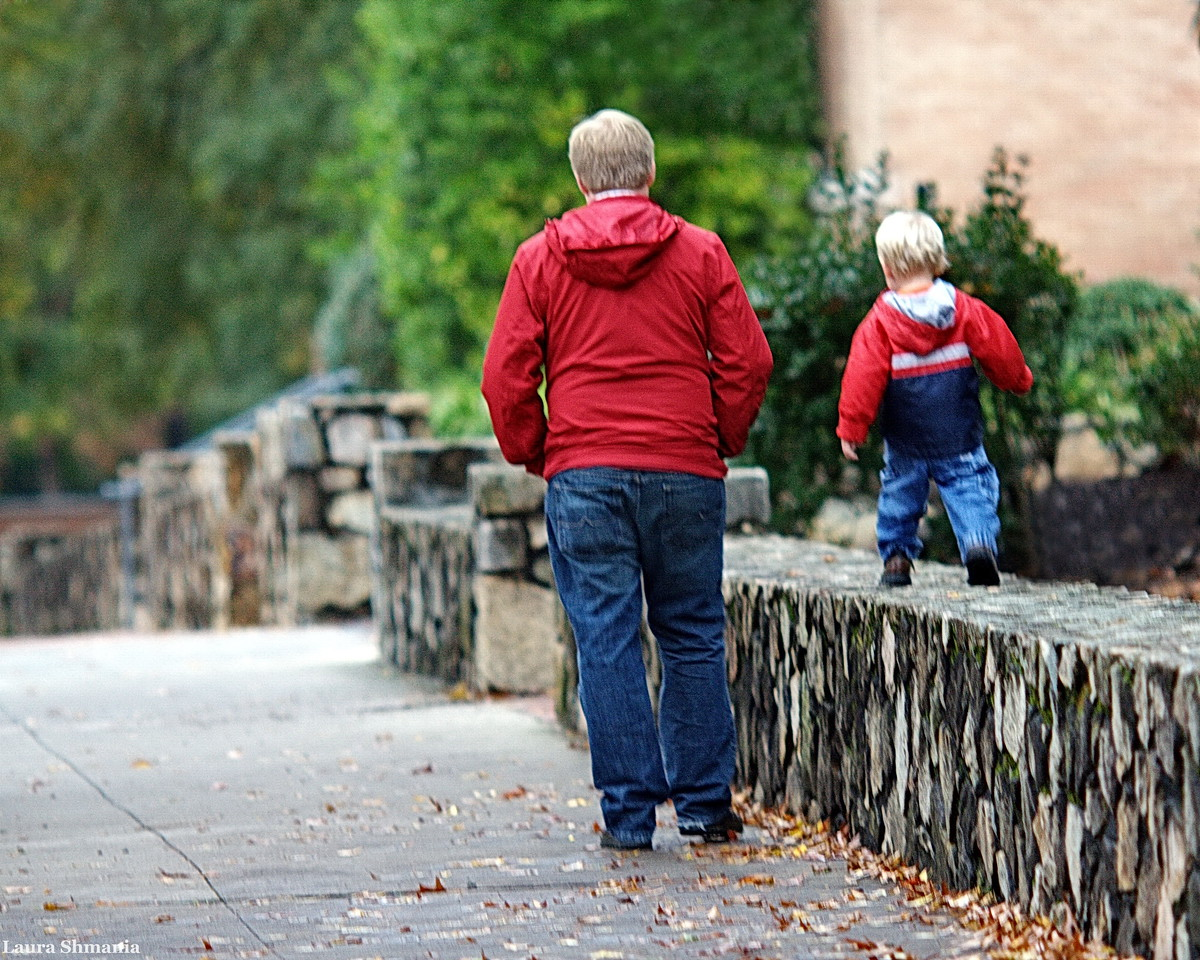 11-2-09-- monday<br /> a favorite kid activity here- walking the stone walls with parent at side