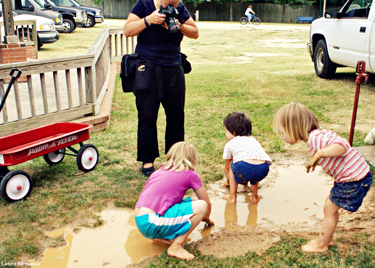 "7-8-09-- wednesday<br /> nothing like mud to draw a child: nothing like a child in mud to draw a photographer...<br /> <br /> ""a three year old child is a being who gets almost as much fun out of a fifty-six dollar set of swings as it does out of finding a small green worm.""<br /> <br /> -- bill vaughan<br /> <br /> will be off-line for a few days and catch up later..."