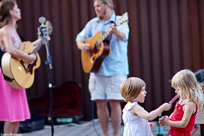 "7-3-09-- friday<br /> musicians at a new local outdoor venue- very family friendly<br /> <br /> ""there are no seven wonders of the world in the eyes of a child.  there are seven million.""<br /> <br /> -- walt streightiff"