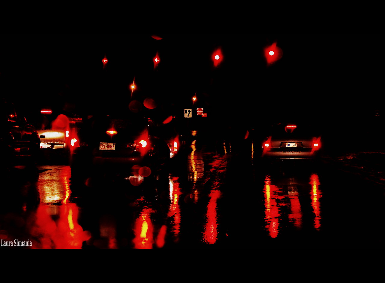 11-11-09-- wednesday<br /> reflections of red... evening meeting had me out driving in the rain... and yes, I was at a full stop when I took this shot!