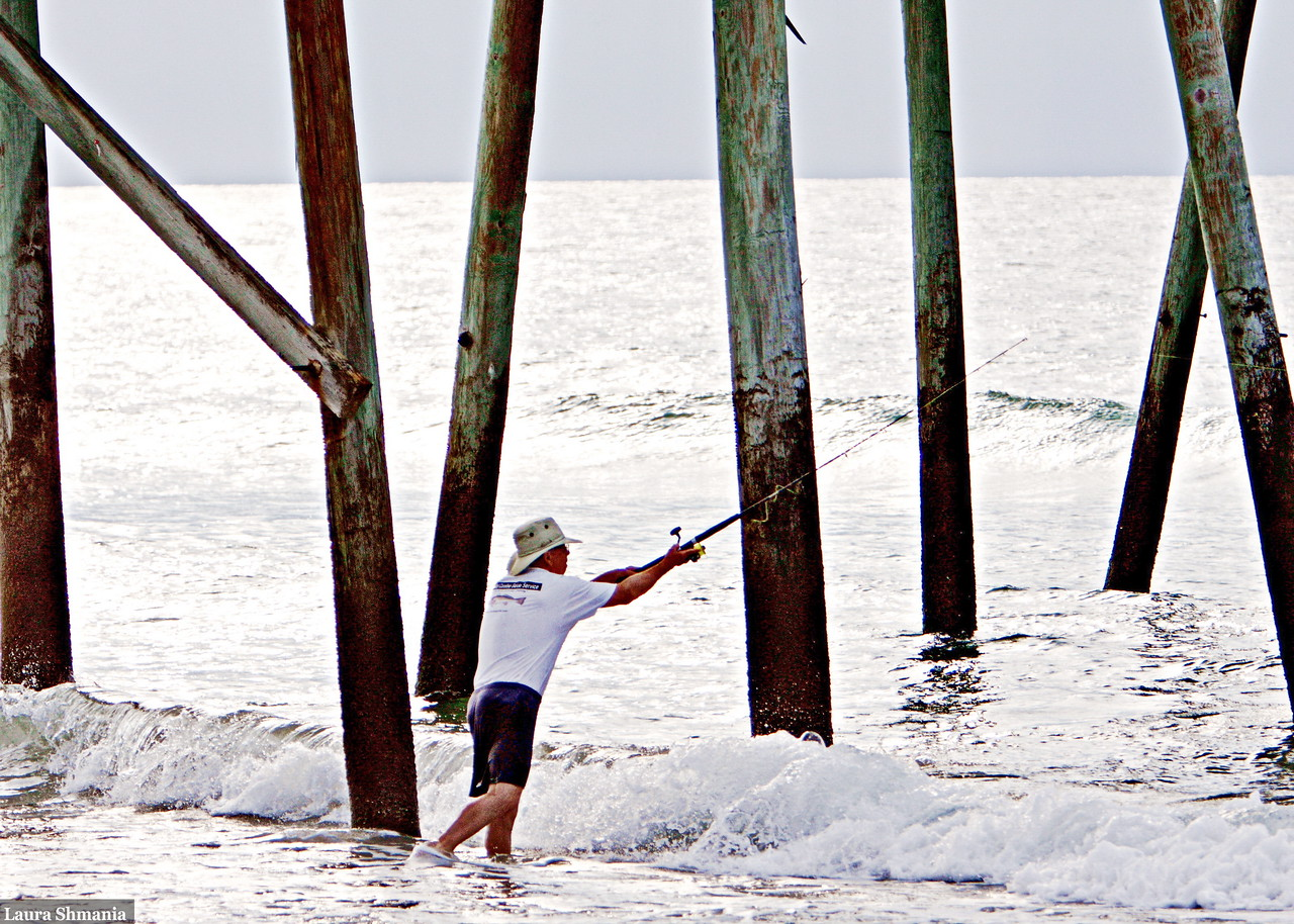 7-14-09-- tuesday<br /> early morning fisherman by the pier