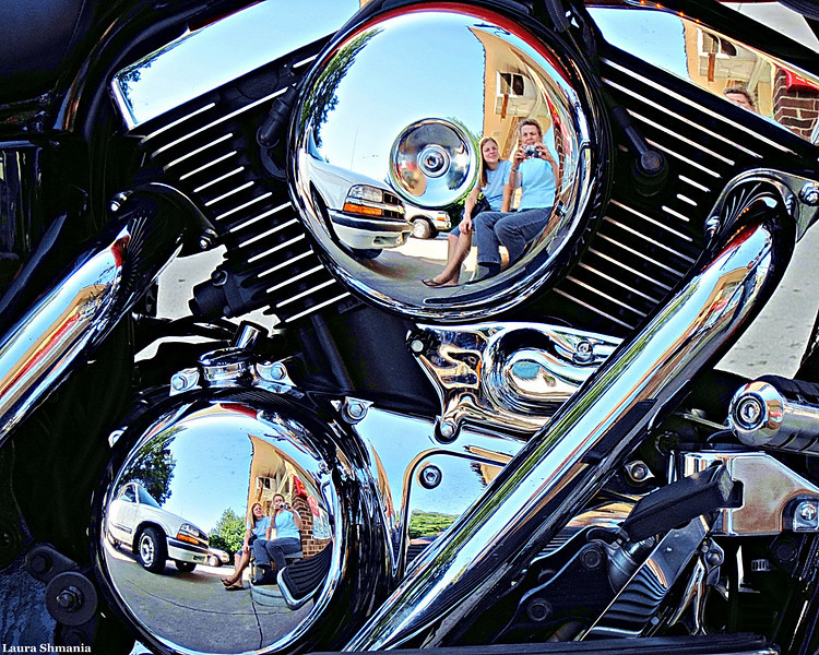 9-6-09-- sunday<br /> home after a really fun road trip with my daughter to her new abode.  this is us reflected in a motorcycle's chrome (ummm... we drove in a car...)