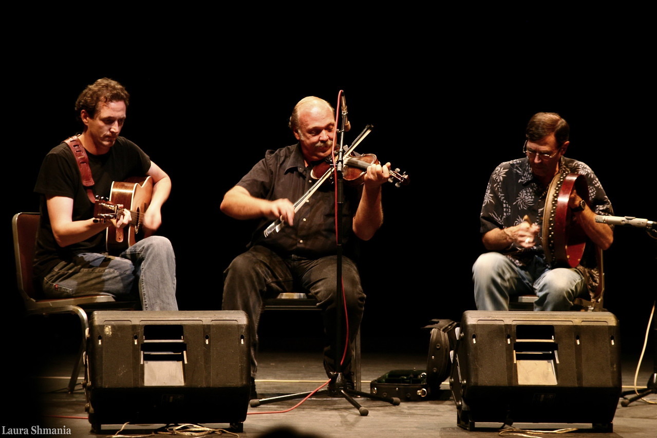 "8-25-09-- tuesday<br /> In memory of Jerry Holland.  I just heard that Jerry Holland, a great Cape Breton fiddler, passed away July 16, 2009.  I had the pleasure of  hearing Jerry play at a retreat in NC several years ago.  I took this picture of him (center stage) playing on July 17, 2006-- exactly 3 years before died.  How poignant.  Jerry was both a composer and steward of traditional  Celtic/Scottish tunes.  He was a warm and humble man and a dynamic performer.  Here is a link to his  music- I encourage you to have a listen.. <br /> <br /> <a href=""http://www.youtube.com/watch?v=1g8dK_OxdRU&feature=related"">http://www.youtube.com/watch?v=1g8dK_OxdRU&feature=related</a> - Jerry playing with his son, Feb 2, 2008<br /> <br /> and a link to his bio:<br /> <a href=""http://www.jerryholland.com/bio.htm"">http://www.jerryholland.com/bio.htm</a><br /> <br /> and a link to a gallery I set up of a music session with Jerry and other great musicians at the retreat (Jerry is in the purple shirt)<br /> <a href=""http://www.butterflites.com/Events/Swannanoa-Gathering/Swannanoa-Gathering-The/1684129_dHTjY#83392795_BxZ2w"">http://www.butterflites.com/Events/Swannanoa-Gathering/Swannanoa-Gathering-The/1684129_dHTjY#83392795_BxZ2w</a>"