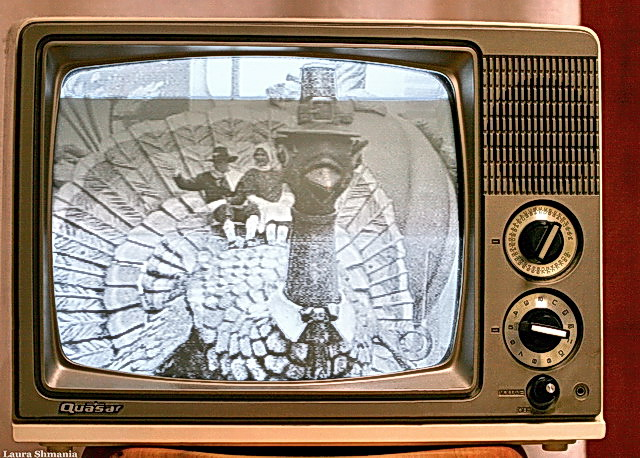 "11-23-06- Thursday macy's day parade as seen on my old  black and white tv.  happy thanksgiving!  ""this being human is a guest house.   every morning a new arrival... be grateful for whoever comes, because each has been sent  as a guide from beyond.""     -- rumi"