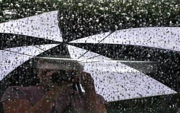 """8-31-06-- Thursday<br /> me and my umbrella <br /> reflected <br /> in my car window <br /> in the rain.<br /> <br /> <br /> """"namaste -- <br /> the God in me greets the God in you."""""""
