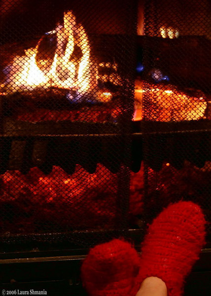 "12-29-06-- Friday<br /> toasty toes by the fire<br /> <br /> <br /> <br /> ""sit by the fire and spin.""<br /> <br /> -- mother goose rhyme"