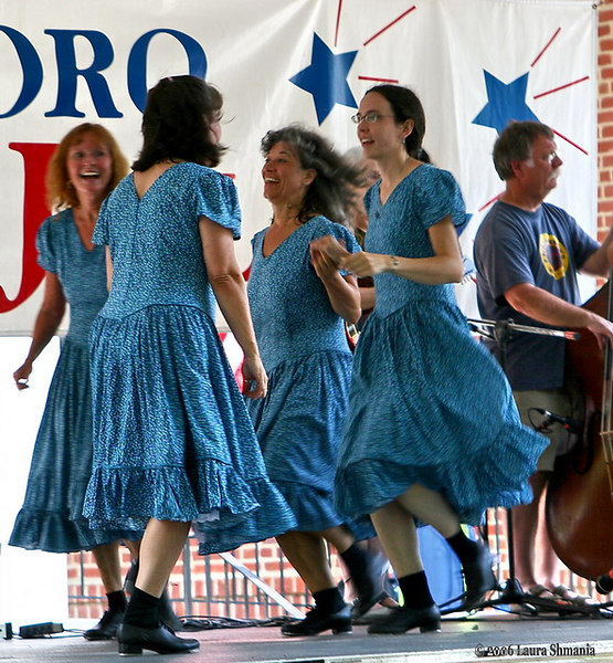 "7-4-06-- Tuesday<br /> cane creek cloggers at the fourth of july celebration <br /> at carrboro town hall.  <br /> <br /> for the collection of event photos, go to<br /> <br /> <a href=""http://butterflites.smugmug.com/gallery/1629069"">http://butterflites.smugmug.com/gallery/1629069</a>"