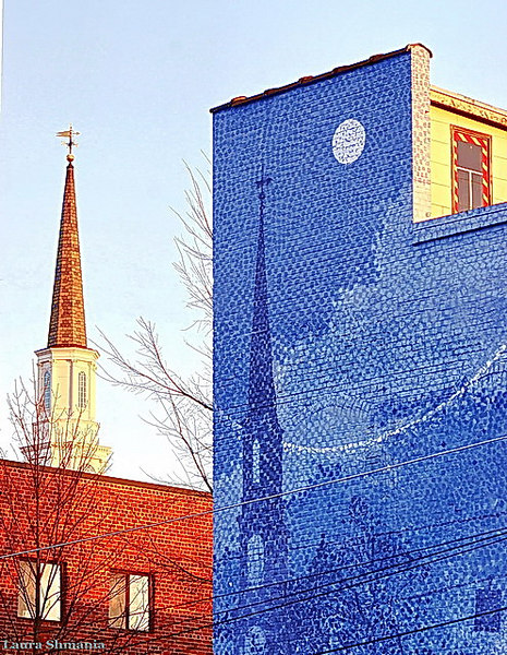 "12-1-06-- Friday church spire and the wall mural it inspired by  local artist michael brown, chapel hill, nc   ""I saw the angel in the marble  and carved until I set him free.""    -- michaelangelo"