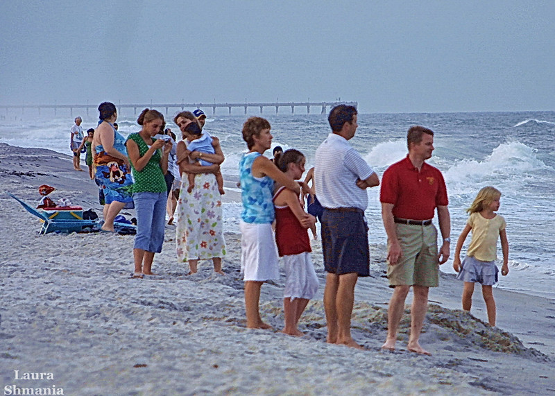 7-15-07-- Sunday<br /> families gather on the beach after dinner at a local restaurant<br /> <br /> <br /> &#8220;the only normal people <br /> are the ones you don&#8217;t know very well!&#8221; <br /> <br /> -- joe ancis