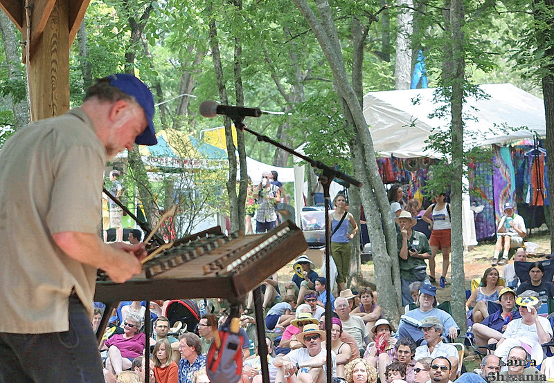 """7-08-07-- Sunday<br /> John McCutcheon performs on the hammer dulcimer at the Festival for the Eno.<br /> <br /> <br /> <a href=""""http://www.enoriver.org/festival/"""">http://www.enoriver.org/festival/</a><br /> <br /> <br /> """"hope is the thing with feathers that perches <br /> in the soul - and sings the tunes without the words - and never stops at all."""" <br /> <br /> -- emily dickinson"""
