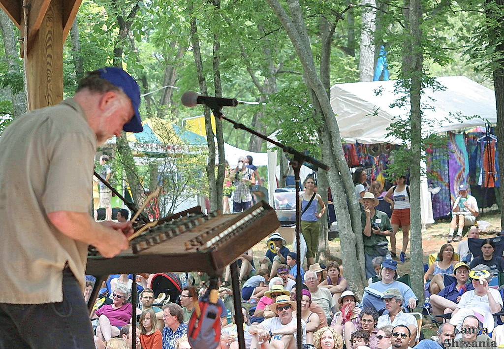 "7-08-07-- Sunday<br /> John McCutcheon performs on the hammer dulcimer at the Festival for the Eno.<br /> <br /> <br /> <a href=""http://www.enoriver.org/festival/"">http://www.enoriver.org/festival/</a><br /> <br /> <br /> ""hope is the thing with feathers that perches <br /> in the soul - and sings the tunes without the words - and never stops at all."" <br /> <br /> -- emily dickinson"