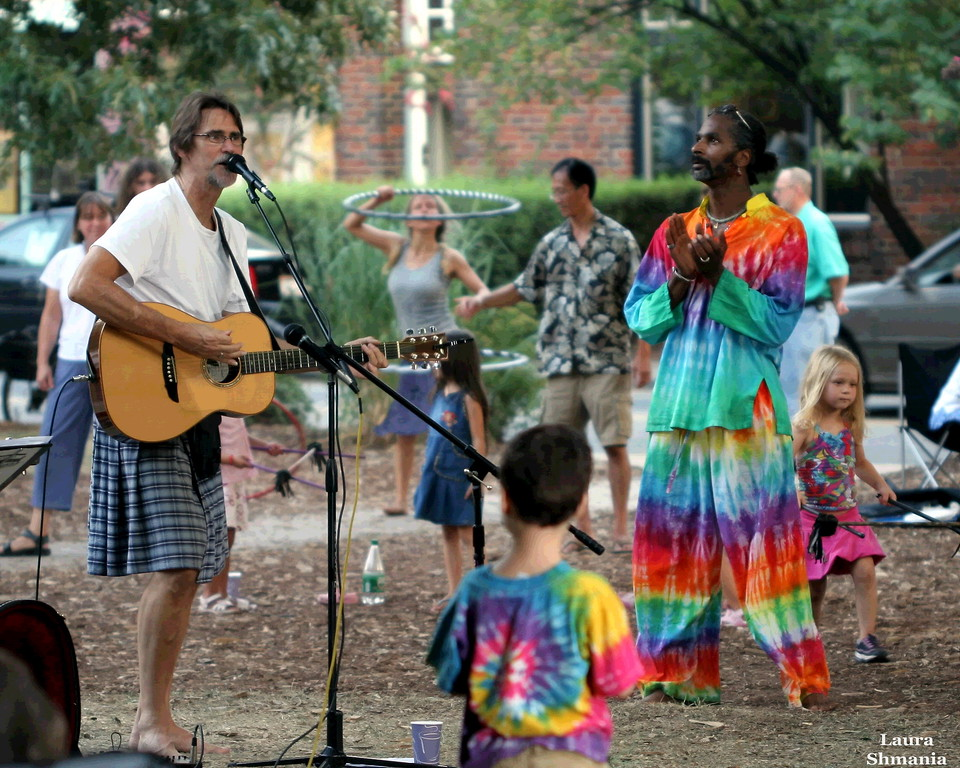 "7-26-07-- Thursday<br /> frolicking on the lawn of weaver street market- <br /> weekly outside music venue<br /> <br /> ""life is too important to be taken seriously!"" <br /> <br /> -- oscar wilde"