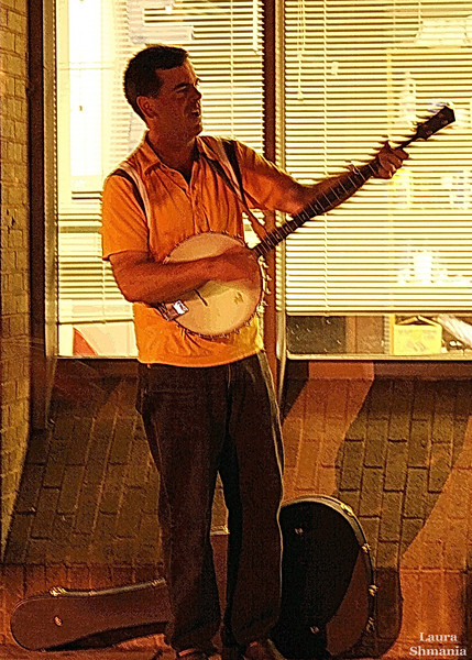"""9-21-07-- Friday<br /> musician entertains folks on the street this evening<br /> <br /> <br /> """"ah, music. a magic beyond all we do here!""""<br /> <br /> j. k. rowling, harry potter and the sorcerer's stone"""