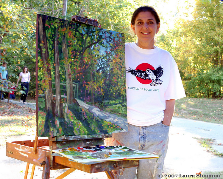 "10-20-07-- Saturday<br /> artist emily weinstein -  <a href=""http://www.WeinsteinArt.com"">http://www.WeinsteinArt.com</a>-  and the painting she painted during the bolin creek festival to be auctioned to raise money to preserve bolin creek- <a href=""http://bolincreek.org"">http://bolincreek.org</a><br /> <br /> ""there are painters who transform the sun to a yellow spot, but there are others who with the help of their art and their intelligence, transform a yellow spot into the sun."" <br /> <br /> -- pablo picasso<br /> <br /> emily's new book release- ""saving magic places""<br /> <br /> <a href=""http://www.weinsteinart.com/magicplaces.html"">http://www.weinsteinart.com/magicplaces.html</a>"