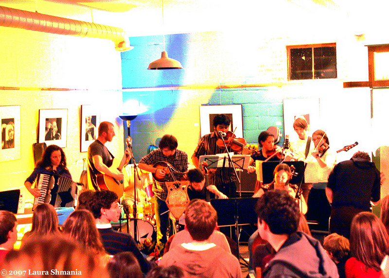 "11-30-07-- Friday<br /> lost in the trees -- a 13-piece mini-orchestra including violins, viola, cello, upright bass, trombone, melodica and banjo -- performs in a tiny corner of the open eye cafe in carrboro.<br /> <br /> <br /> ""music washes away from the soul the dust of everyday life.""<br /> <br /> -- berthold auerbach"
