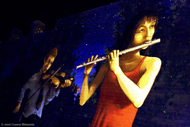 "11-14-07-- Wednesday<br /> my favorite of the chapel hill murals by artist michael brown- at night- on the outside wall of an art supply store<br /> <br /> ""music is the poetry of the air.""<br /> <br /> -- richter"