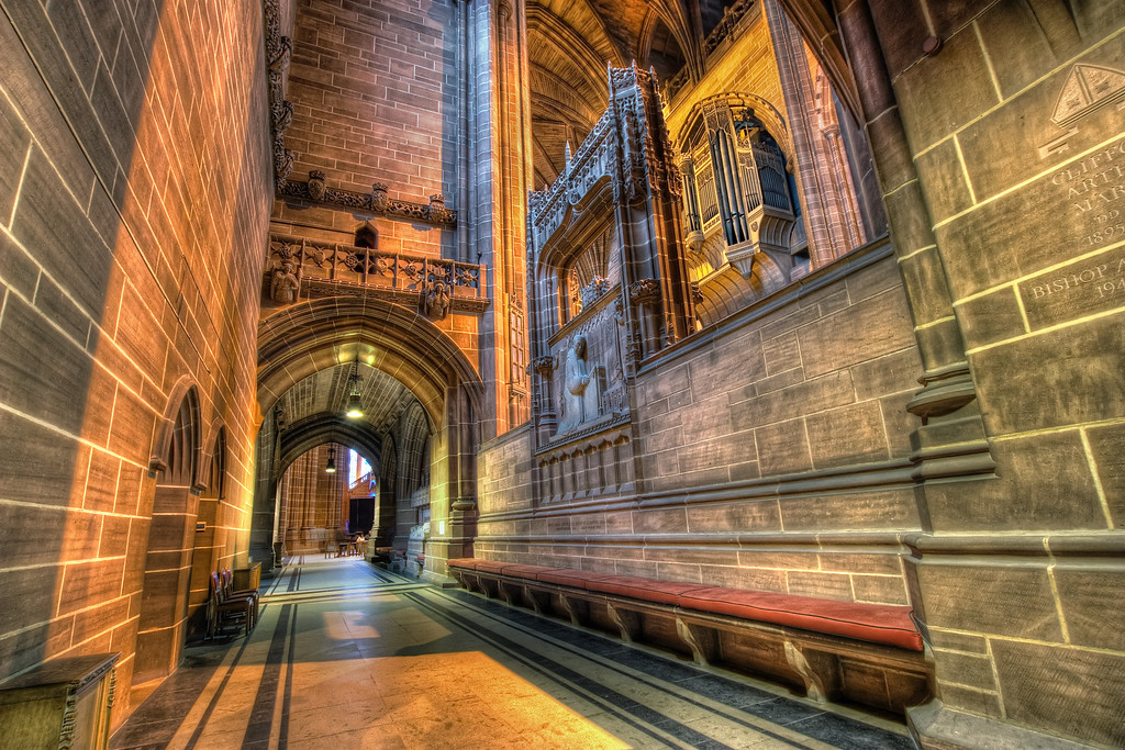 Side Alley Everybody takes photos in the main area of the Liverpool Cathedral and nobody takes photos here. Probably because it was quite dark. I was actually quite glad, because few people walked in front of my camera and due to the low amount of light, there are not on my photo :)HDR from three shots, taken with Canon 450D with Sigma 10-20mm lens, from a tripod. Photo taken at the Liverpool Cathedral in Liverpool