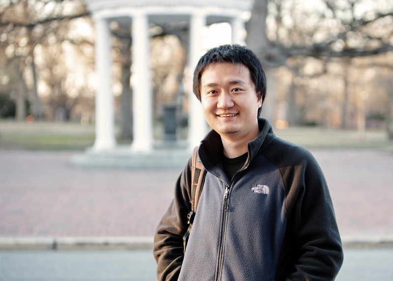 Perfect day for a portrait in front of the Old Well. A PhD grad in cell biology - he lives nearby and spends time enjoying the sights around campus.