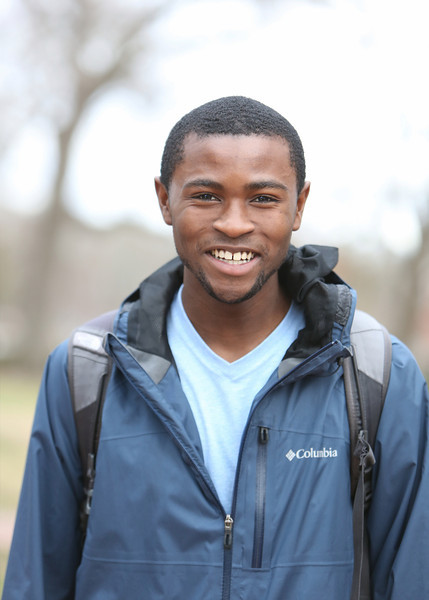 """Started out this afternoon taking shots of blossoms on trees lining the walkway. I turned around and saw this fellow, smiling. So, naturally, I asked if I could take his portrait. He said had seen me taking photos and wondered if I would take his! Perfect! He's graduating this spring and will really miss the community. After taking some time off, he'll be going to law school. """"I'll keep Carolina near and dear to my heart."""""""