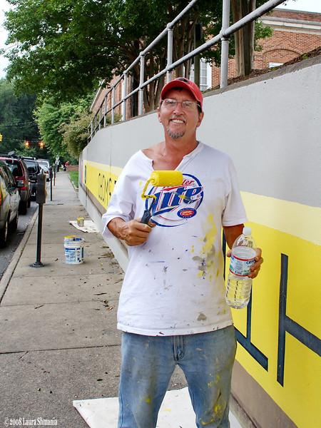 Michael Brown, restoring the mural as part of the mural restoration project of the Preservation Society of Chapel Hill.