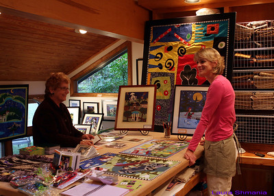 Elaine O'Neil (right) chats with a visitor to her studio textile collage artist