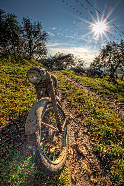 Bike and SunThe weather last weekend was really beautiful. I took a lot of photos of nice old machines, and this is one of them :). I will definitely be uploading more in the next days.HDR from three shots, taken with Canon 450D with Sigma 10-20mm lens, from a tripod.