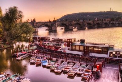 Boats, bridge and sunset  Another of my favorite places in Prague. I really like the composition you can make here, with the boats in the foreground and the Karl's bridge in the background.  HDR from three shots, taken with Canon 7D with Sigma 10-20mm lens, from a tripod.