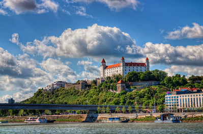 One sunny day  After all the night and sunset shots of the Bratislava Castle, how about a nice one from a sunny day :). I wasn't even planing to take any photos that day, but there were such great clouds over the city, that I had to take few photos.  HDR from three shots, taken with Canon 450D with Sigma 18-50mm lens, handheld.