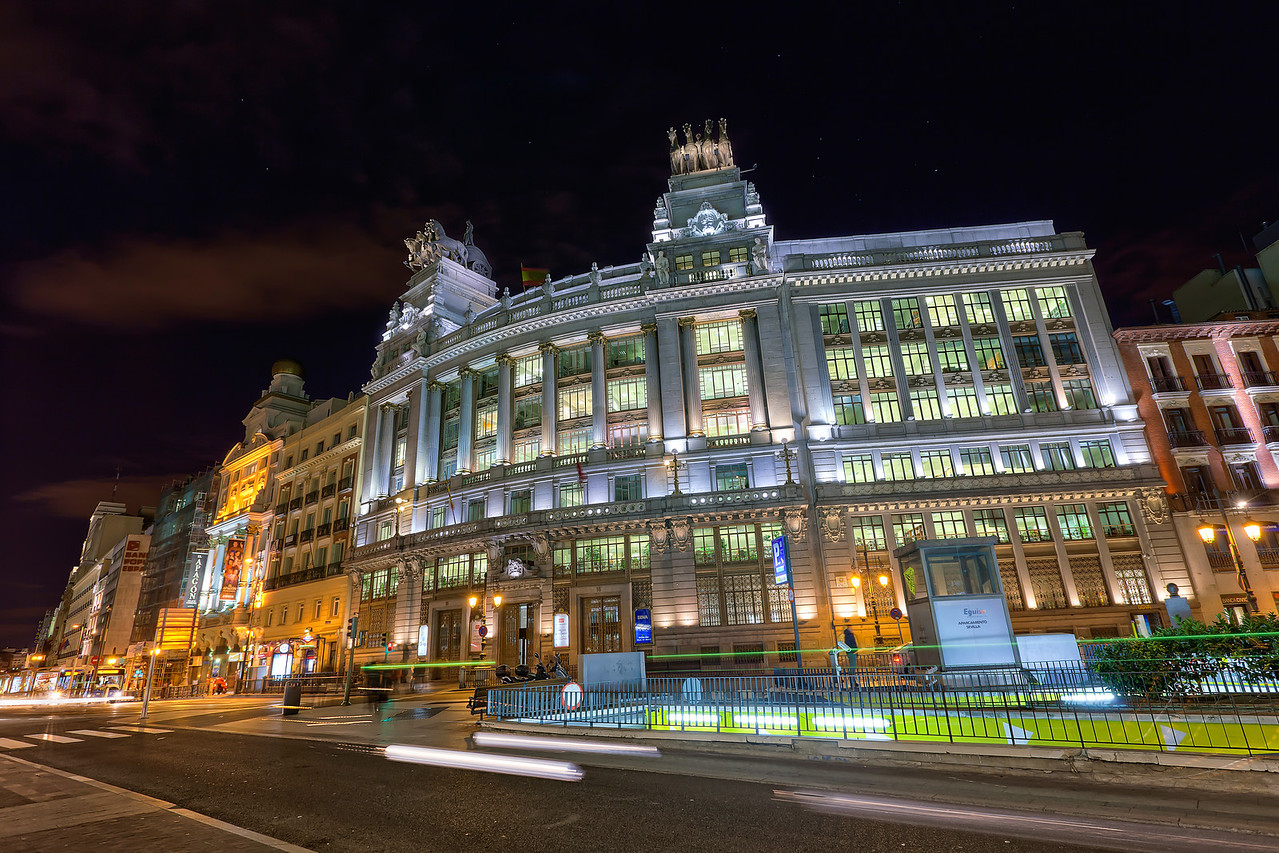 Exploring Madrid after dark  Each day I was in Madrid, I tried to take at least a few shots after sunset. I only managed to take a few, as I was quite tired after a whole day of walking :).   This photo was combined using Photomatix and also Oloneo Photo engine. What I have noticed is, that Oloneo is really great when you have some very dark areas in your photo. It creates much less artifacts in the final result. I used it for the sky in this shot.  Get more info about this photo on my blog http://blog.hdrshooter.net