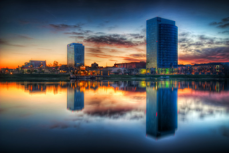 Reflection Towers  Another one from the Kuchajda lake in Bratislava. It's always nice to have something near water, something to have a reflection :)  HDR from three shots, taken with Canon 450D with Sigma 10-20mm lens, from a tripod