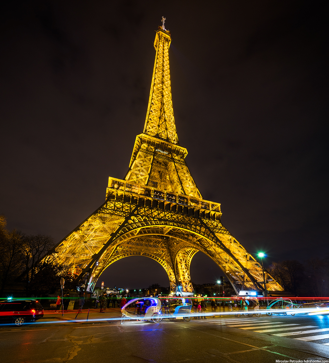 Eiffel tower glowing in the night, Paris, France