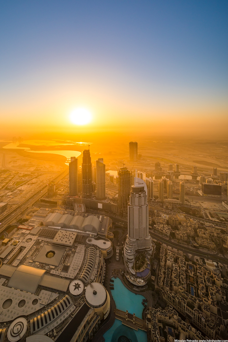 The huge sun at the horizon, Dubai, UAE