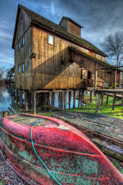 "The red boat in front of the water mill  Another one of my older shots, from my ""backup"" list (photos which I post, when I have no time to edit new ones :)). But If nothing went wrong, I should have spend the whole weekend taking new photos, so there should be something new tomorrow :)  HDR from three shots, taken with Canon 450D with Sigma 10-20mm lens, from a tripod."