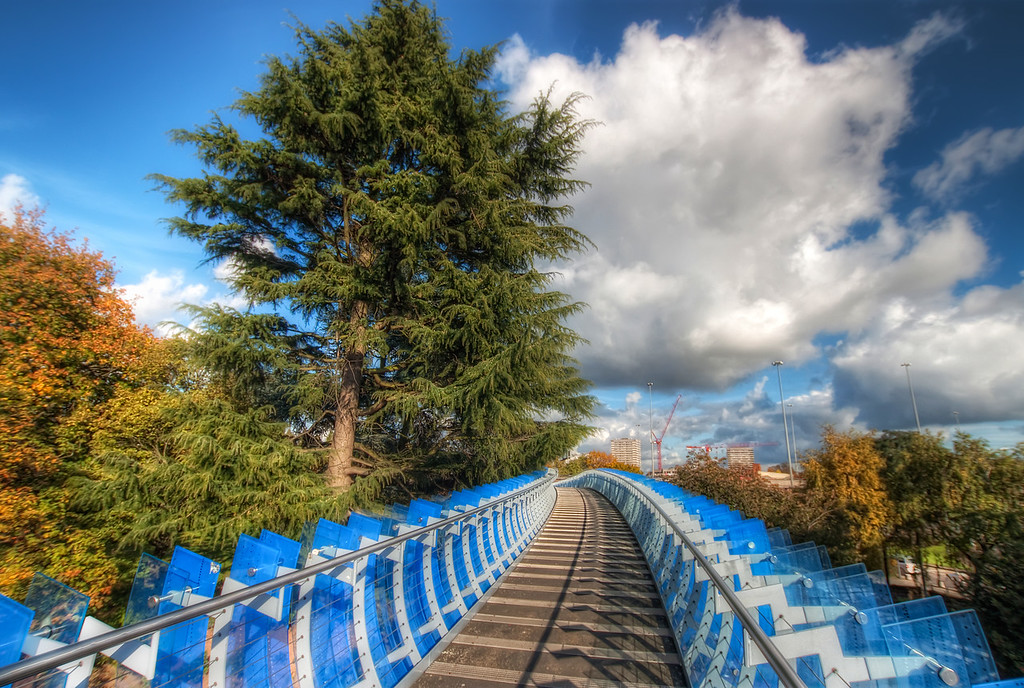 Blue walkway in CoventryWhat a nice day it was. I took this close to the end of October 2010. It was really warm and sunny :). This walkway is right next to a big transport museum in Coventry, Uk. I really regret that I went there without a tripod. I have many photos, but very few good ones. But there definitely will be another visit one day :)HDR from three shots, taken with Canon 450D with Sigma 10-20mm lens, handheld.