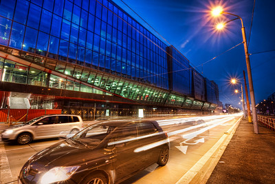 Faster than Light  When I saw the three original shots here, I knew what I wanted this photo to look like :). Making this small car look like the fastest car on earth :). So I masked in the car from one from one of the shots and the light trais from another.  HDR from three shots, taken with Canon 450D with Sigma 10-20mm lens, from a tripod. Photo taken in front of the Ondrej Nepela Arena in Bratislava.