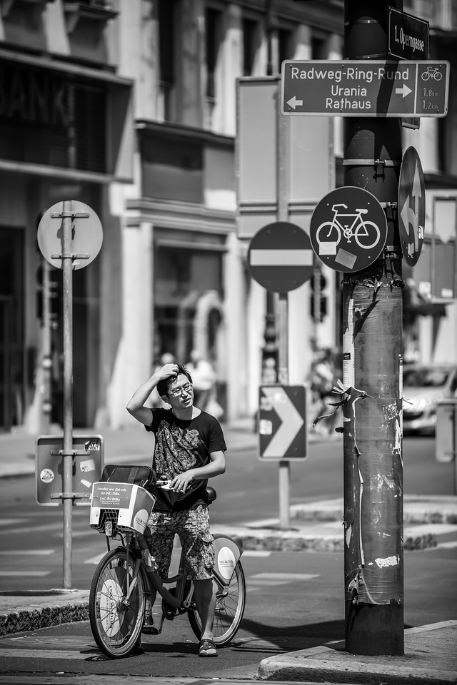 Which way now? I just love how all the elements came together here. The biker, looking like hes thinking about the way, and all the road signs around him. Just great :)