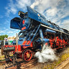 Letting off steam<br /> <br /> There was a gathering of historical trains in Bratislava this weekend (called Rendez), so I had to go there to take few shots. This was my favorite, from all the trains there :). And even the weather played along nicely, with the clouds breaking up few minutes after I arrived there :)<br /> <br /> HDR from three shots, taken with Canon 450D with Sigma 10-20mm lens, from a tripod.