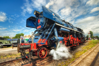 Letting off steam  There was a gathering of historical trains in Bratislava this weekend (called Rendez), so I had to go there to take few shots. This was my favorite, from all the trains there :). And even the weather played along nicely, with the clouds breaking up few minutes after I arrived there :)  HDR from three shots, taken with Canon 450D with Sigma 10-20mm lens, from a tripod.