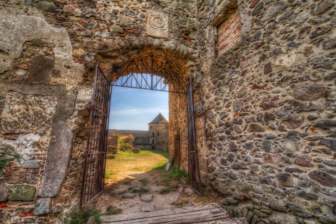 Entry gate  I had another sunrise shot for today, but then decided to go with something a little different. This is the entrance to the Bzovík Fortified Monastery in the village Bzovík in central Slovakia. It's mostly in ruins, but it still is a great subject for HDR (and a little bit dangerous as the sign after the entrance warns :)).   I used a little different HDR processing on this one. I created a tonemapped image and a double tonemapped one (you hit tonemaping once more, when you are done in photomatix). Then I merged this two around 50% from each and I used the center part from the once tonemapped image.  HDR from three shots, taken with Canon 7D with Sigma 10-20mm lens from a tripod.