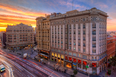 Madrid sunrise I took this very colorful photo while I was in Madrid earlier this year. I took this directly from the balcony of my hotel room, during a sunrise. It's really great how late the sunrise in Spain is, as they use the same time as central Europe, but are much more further to the west :)