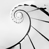 Spiral<br /> <br /> I tried a little minimalistic B&W photography. This photo was taken with my 10-20mm lens, I then just cropped it, to make a better composition, as it was centered. Taken handheld inside the staircase of the Minaret in Lednice.