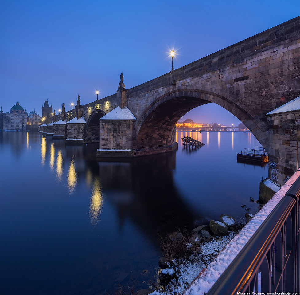Winter morning at the Charles bridge Prague Czech Republic