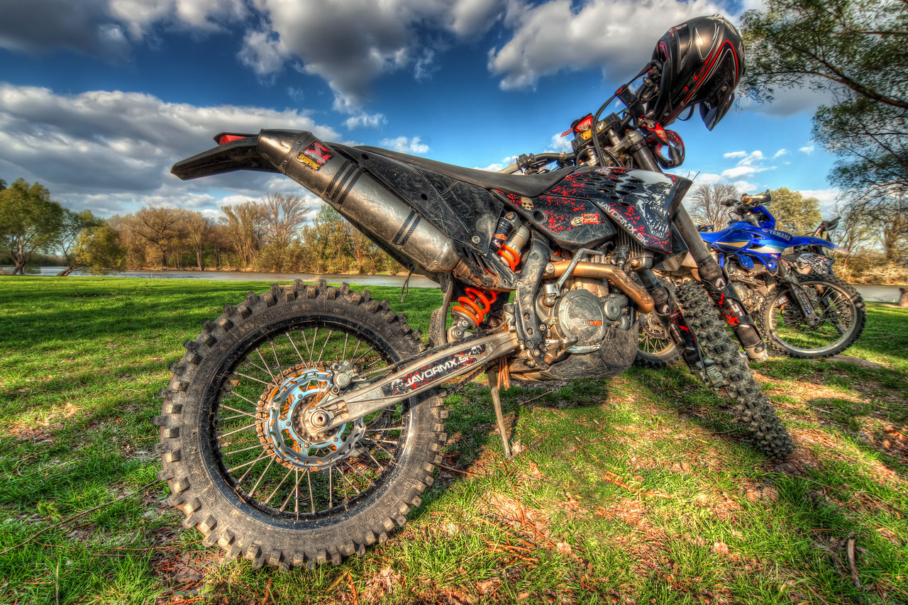 Motocross Bikes  How about a nice change of a subject :). I think that over the last year I uploaded only one photo of a bike, so that will change for better now. I took a lot of shots of these bikes and will upload more of them later on.  HDR from three shots, taken with Canon 450D with Sigma 10-20mm lens, from a tripod.