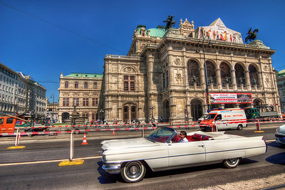 White Cadillac  Just a random photo from Vienna today :) You don't see many cars like this one here, so I took the shot :) You can see the Vienna Opera house in the back.  HDR from a single RAW file, taken with Canon 450D with Sigma 10-20mm, handheld.