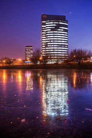 Millenium towers on ice  Another photo already taken with the Canon 5D. I'm starting to really like this camera. The difference is clearly visible. This photo is also mostly from the original shot. The HDR was used only on the building and the ice. In booth cases to add more detail to the area.  In this photo the Millenium towers of the Polus city center in Bratislava, and their reflection in the frozen Kuchajda lake.  HDR from three shots, taken with Canon 5D mark II with Canon 24-70mm F2.8 lens, from a tripod