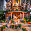 <h2>Small nativity scene</h2> This is a small nativity scene in the St. Stephens Cathedral in Vienna. There were two of these, one of each side of the cathedral. This HDR is only from a single RAW file, as no tripods allowed and for this I held the camera down on a railing. Looks quite good for a 2s exposure :)