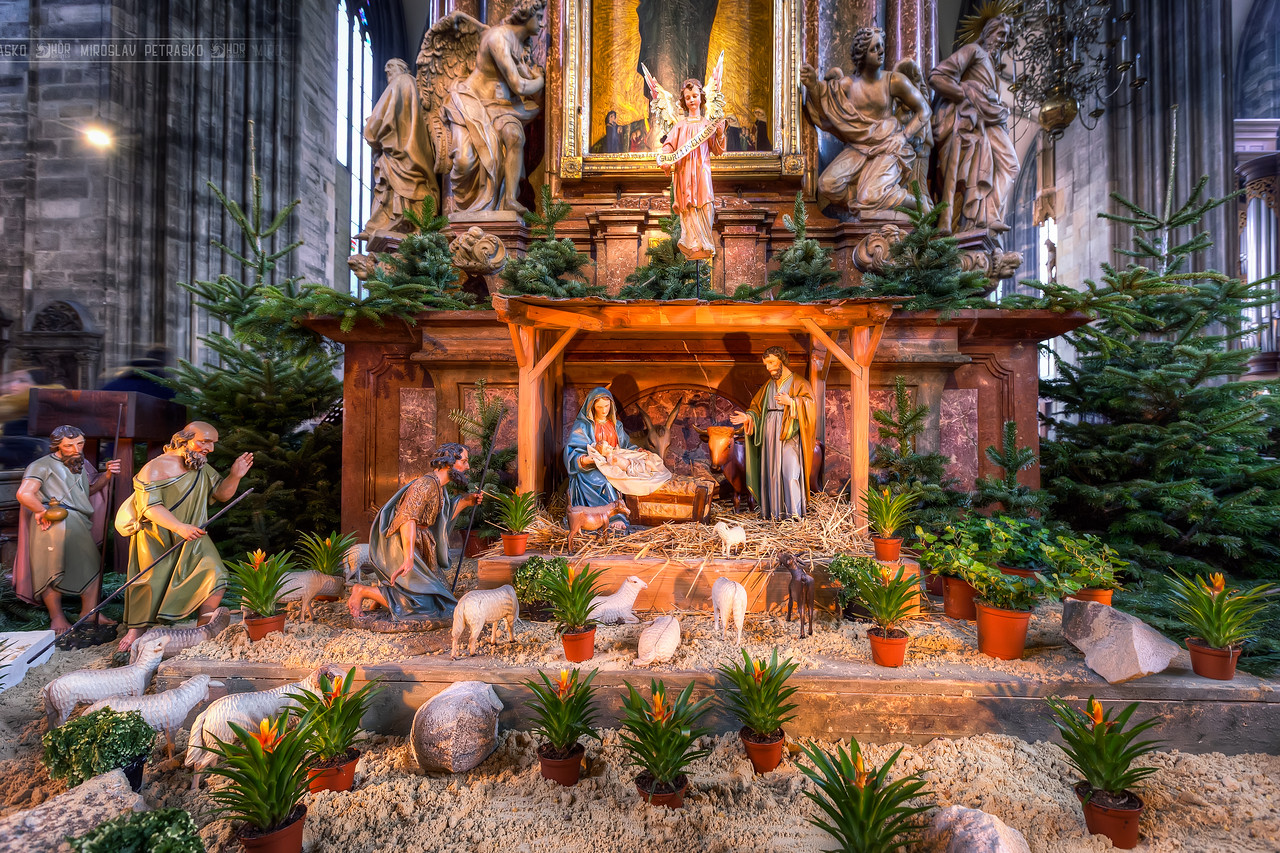Small nativity scene This is a small nativity scene in the St. Stephens Cathedral in Vienna. There were two of these, one of each side of the cathedral. This HDR is only from a single RAW file, as no tripods allowed and for this I held the camera down on a railing. Looks quite good for a 2s exposure :)